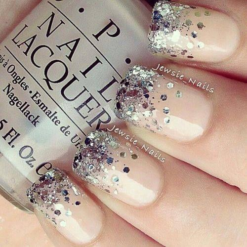Glitter Nails. A nice glamorous look to go with that white dress with chrome steel jewelry.