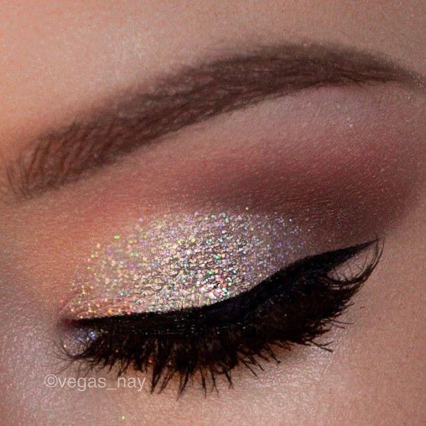 silver iridescent glitter on the lid and thick cat eye