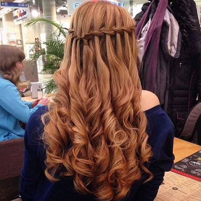 Curled hair to the side with braid