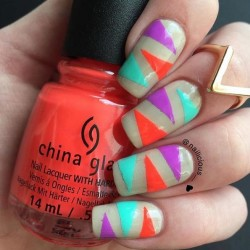 Edgy neon triangle nails